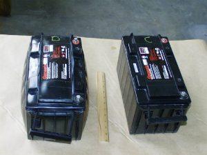 batterie voiture gonflée et endommagée